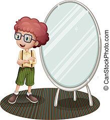 A young boy near the mirror