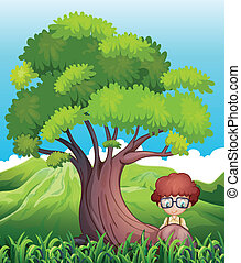 A young boy near the roots of the giant tree