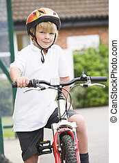 A young boy on a bicycle