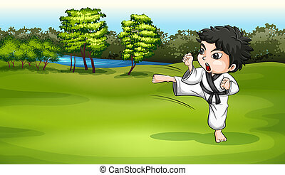 A young boy practicing karate near the river