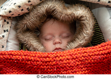 young boy sleeping in the stroller