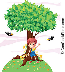 A young boy standing under a big tree with two birds