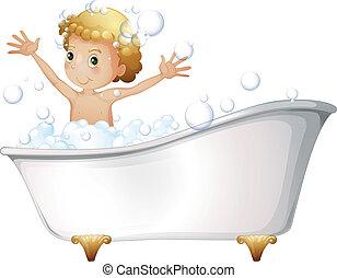 A young boy taking a bath at the bathtub