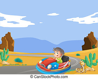 A young boy travelling at the desert