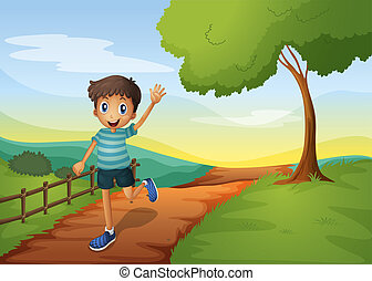 A young boy waving his hand while running