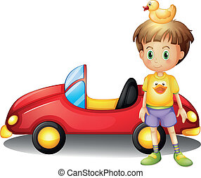 A young boy with a rubber duck and a big toy car