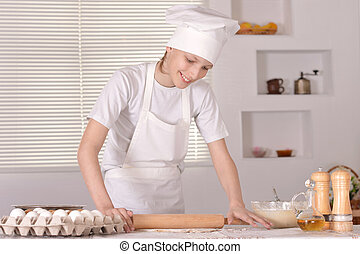A young boy with dough
