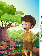 A young boyscout in the forest