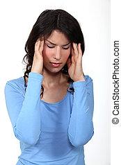 A young brunette having a headache.