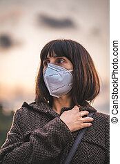 A young brunette with a mask. First walks of the uncontrolled Covid-19 pandemic