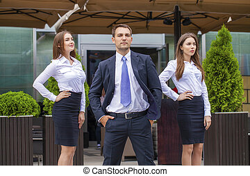 A young businessman with their secretaries
