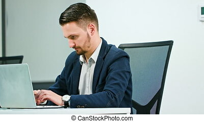 A Young Businessman Working on the Laptop