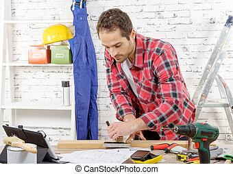 young carpenter measuring board