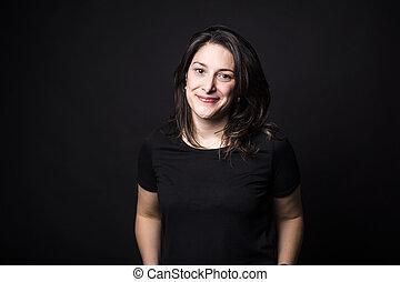 young caucasian woman portrait on black background