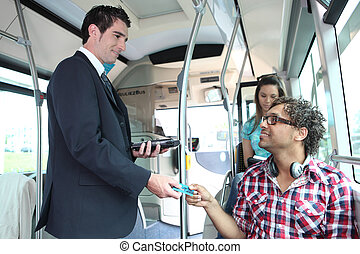 A young controller controlling passengers in a bus.