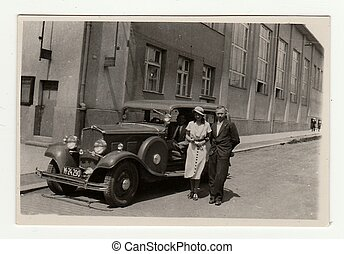 A young couple and vintage car