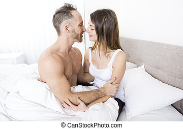 Young couple in bed on the morning