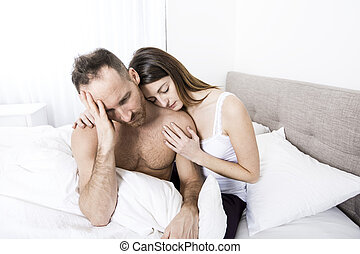 young couple in bed with relation problems