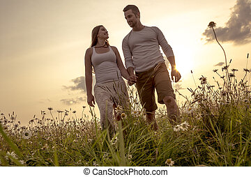 Young couple in love outdoor at the sunset