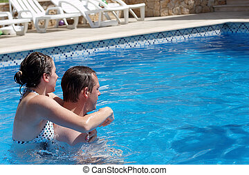 A young couple in the swimming  pool