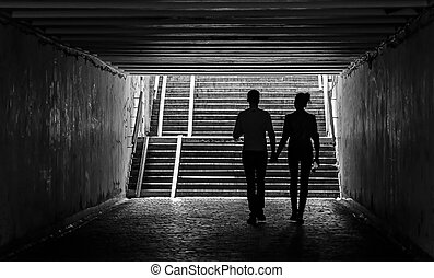 A young couple in the underpass.