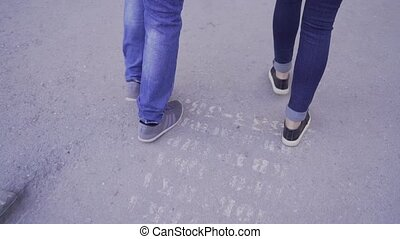 A young couple is walking around the city.