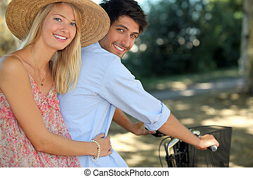 A young couple on a bike ride.