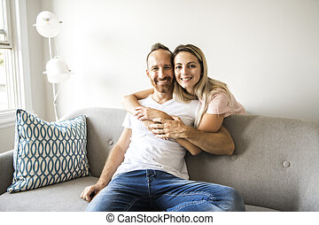 Young couple on the sofa relaxing at home