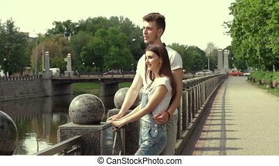 a young couple walks along the promenade