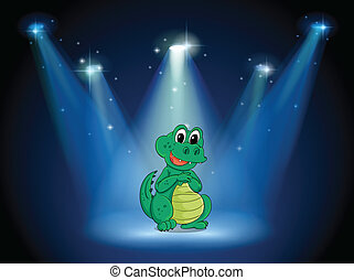 A young crocodile at the stage with spotlights