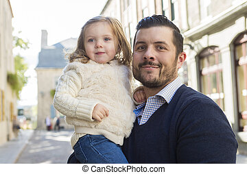 Young dad with her daughter