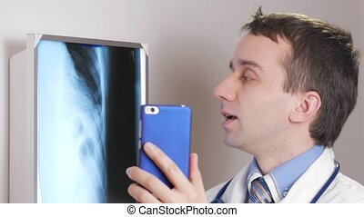 A young doctor consults a patient via the Internet. Video...