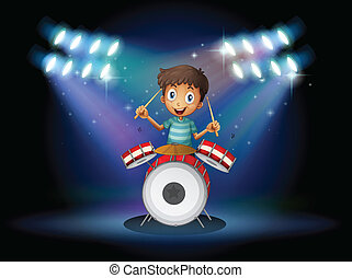 A young drummer at the center of the stage