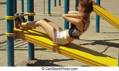 a young energetic girl shakes press on a bench