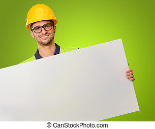 A Young Engineer Holding Placard On Green Background