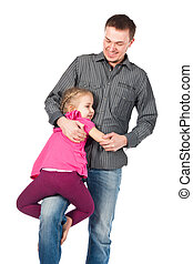 A young father and daughter playing