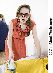 young furious woman ironing yellow dress