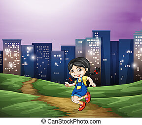 A young girl across the tall buildings in the city