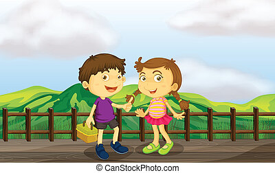 A young girl and a young boy at the wooden bridge