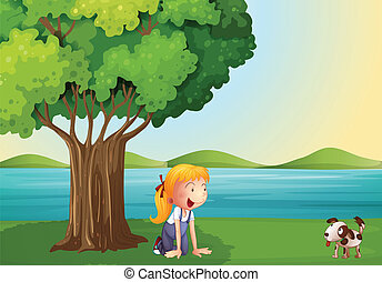 A young girl and her pet near the tree