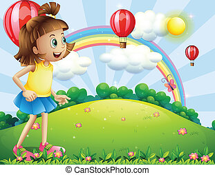 A young girl at the hilltop watching the floating balloons