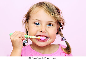A young girl brushing her teeth