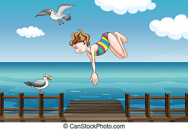 A young girl diving