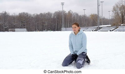 A young girl goes in for sports. Winter