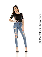 A young girl in a ripped jeans