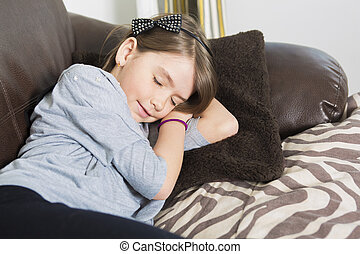 Young girl in a sofa