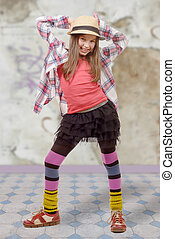 young girl in hipster style with hat