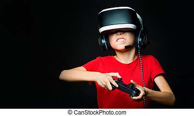 A young girl in VR playing video games with excited face. Photo on dark background.