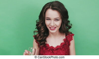 A young girl is drinking champagne