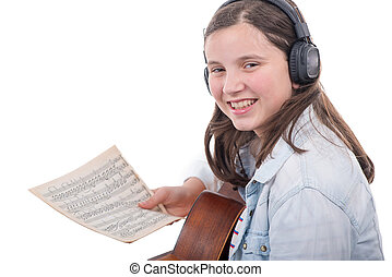 young girl learns to play guitar